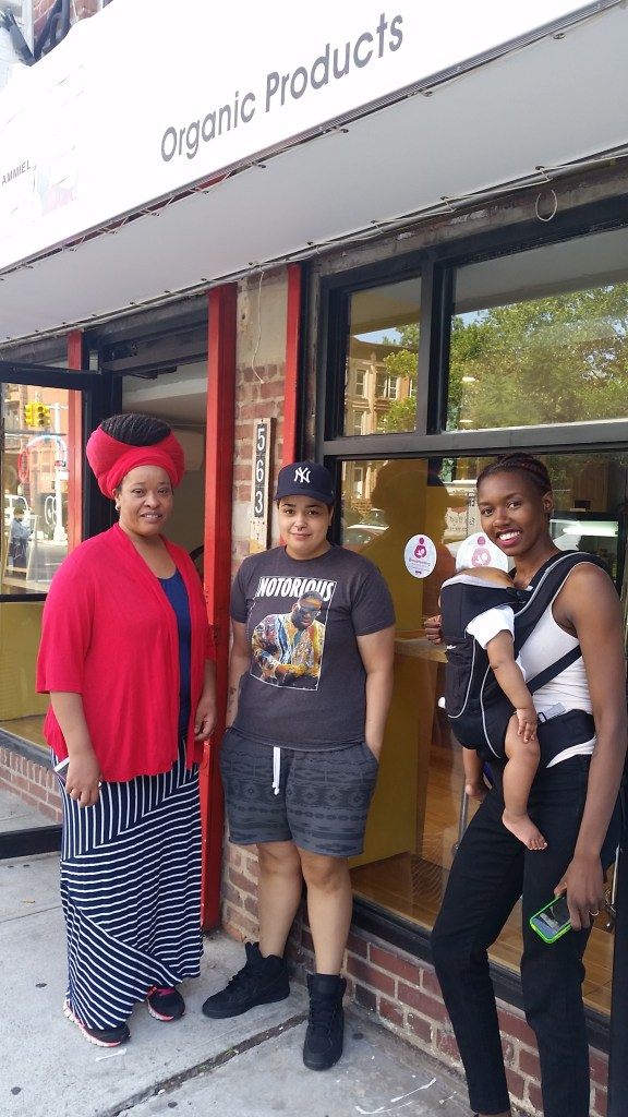 """Desree Foster - BFEZ Volunteer/LIU Student Intern Stephanie Lastra- Employee of Juices Jelisa Tannis - BFEZ CLC & Baby. """"Juice"""" is located on Throop Avenue in Bedford-Stuyvesant and is currently a breastfeeding friendly establishment for mothers."""