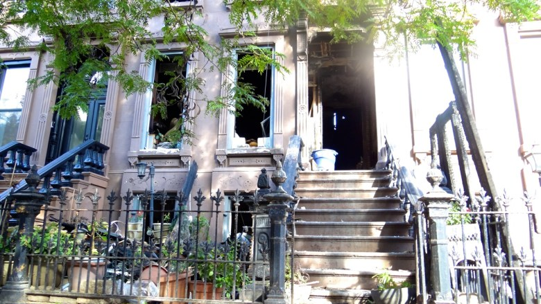A fire Tuesday night destroyed a brownstone at 103 Hancock St, leaving two dead and two injured