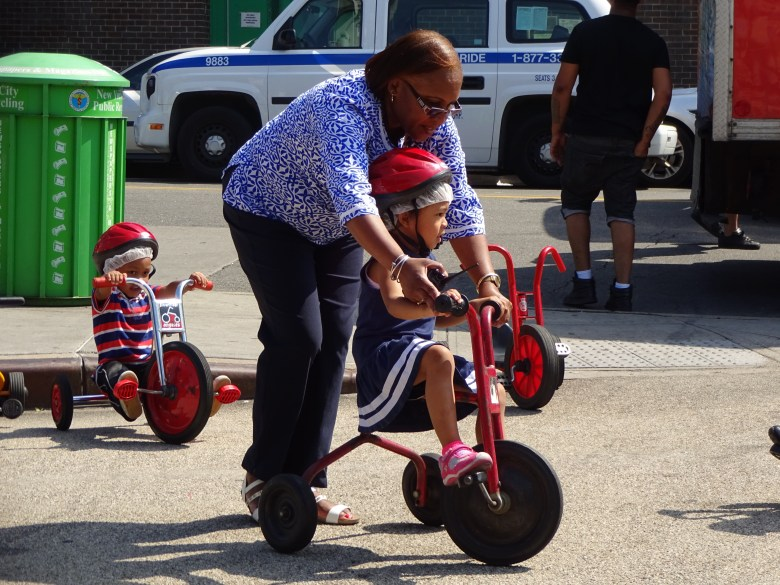 Trike-a-thon, Young Minds Preschool, Carolie Mills, FAB Alliance, Putnam Triangle Plaza, tricycles, bicycles, safety, Clinton Hill, Brooklyn Public Library, Pop-up Reading Room
