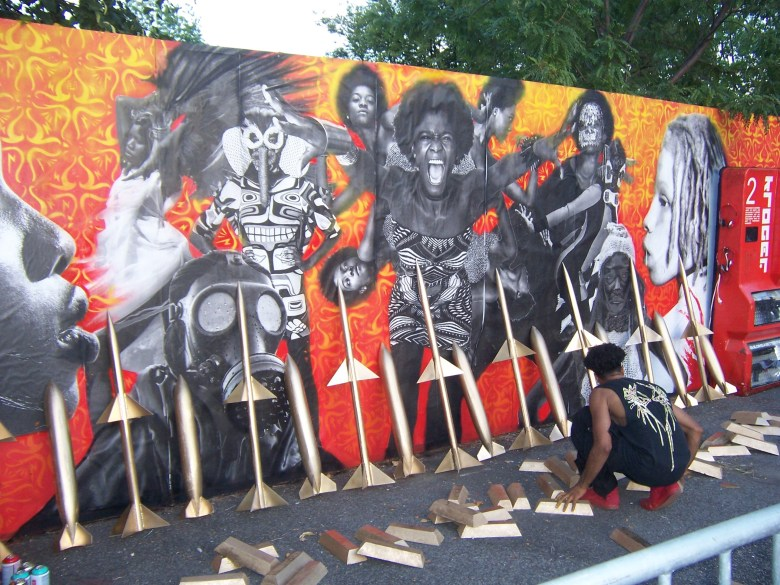 Artist Miguel Ovalle at work on his wall mural at Afropunk 2016