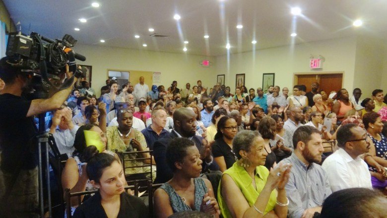 Residents gather for a town hall on a proposed new homeless shelter site in Bed-Stuy