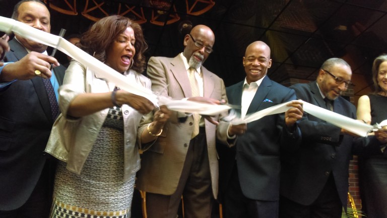 Former City Councilmember Al Vann leads the ribbon-cutting of the re-opening of the Billie Holiday Theatre