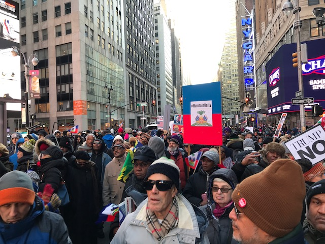 Haiti Cultural Exchange, Rally Against Racism, Times Square, Harry Djanite, Haitian Community, New York City, protest, racism, Donald Trump, shithole countries