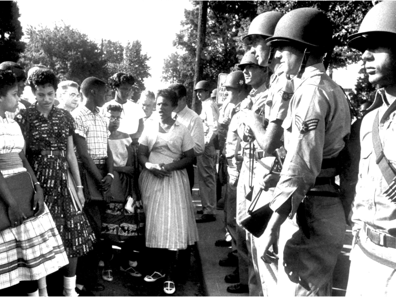 The Little Rock Nine, the first black students to attend their city's formerly segregated high school.