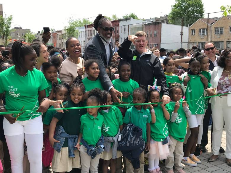 Assemblywoman Tremaine Wright, Councilman Robert Cornegy, and Carter Strickland of the Trust for Public Land cut the ribbon at the opening ceremony