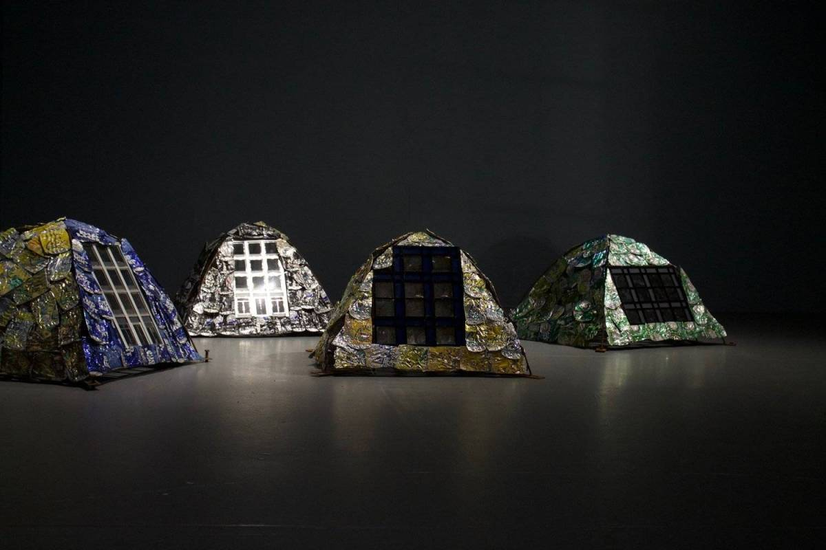 The installation challenges viewers to reflect on mass homelessness caused by lack of affordable housing and the prevalence of luxury development
