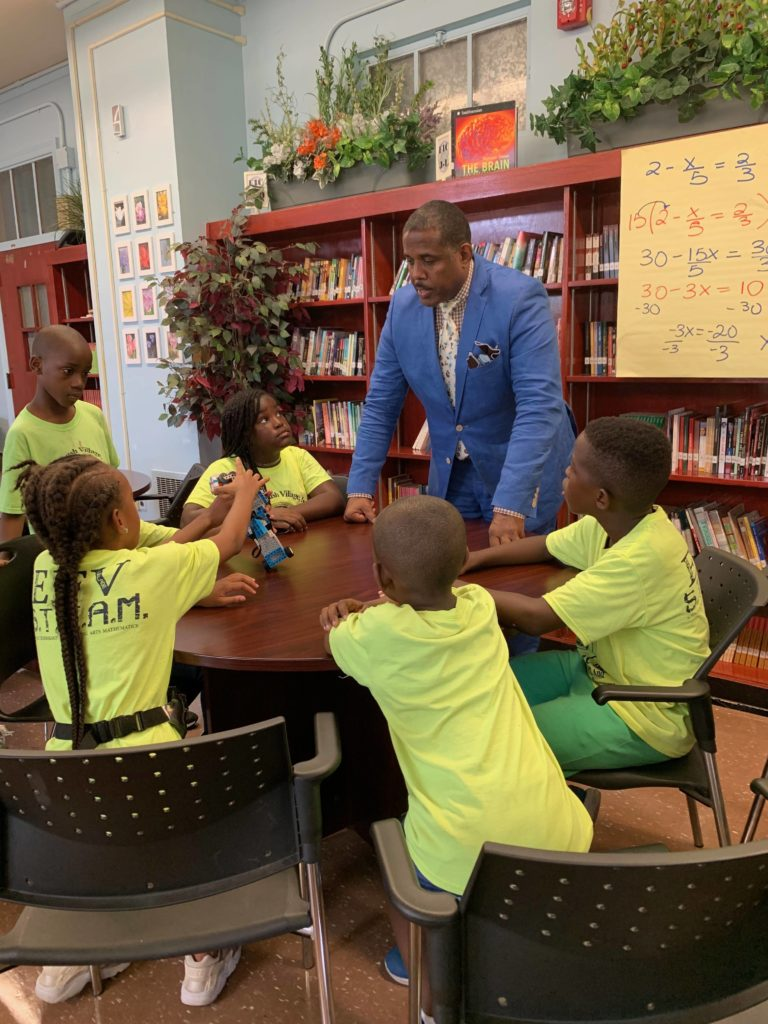 State Senator Kevin Parker was impressed with the tech skills of the EVF kids in Flatbush.