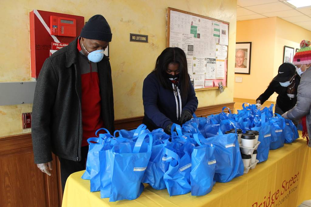 Henry Butler and Assemblywoman Tremaine Wright hand out soup at Quincy Senior Residences. Photo: Anna Bradley-Smith.