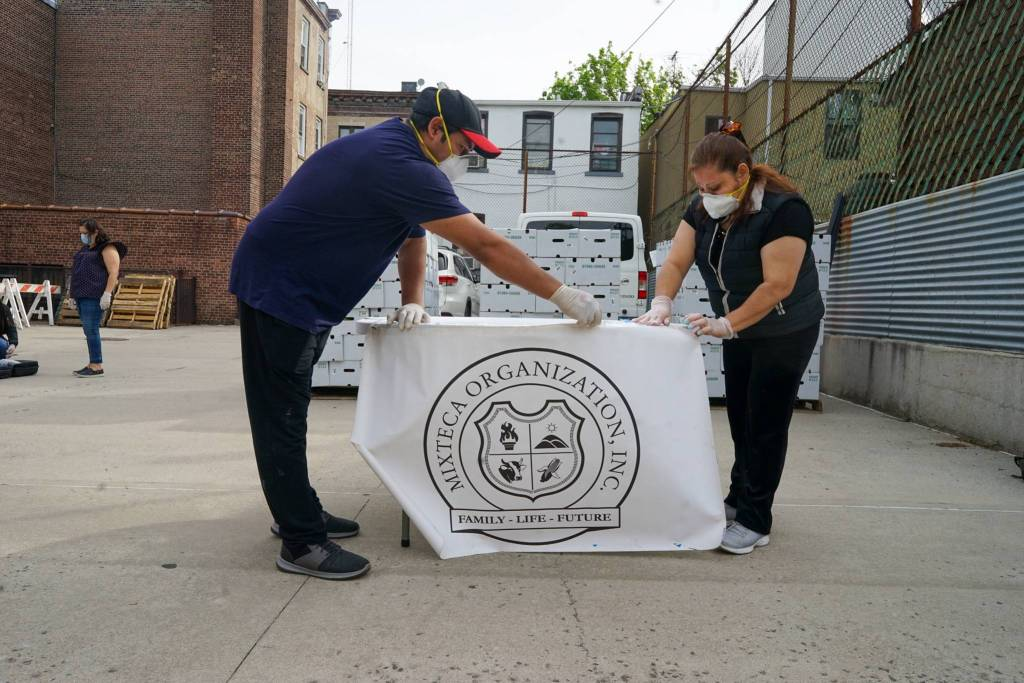 Volunteers with Mixteca set up tables in the Trinity Lutheran Church carpark. Photo by Russell Frederick.