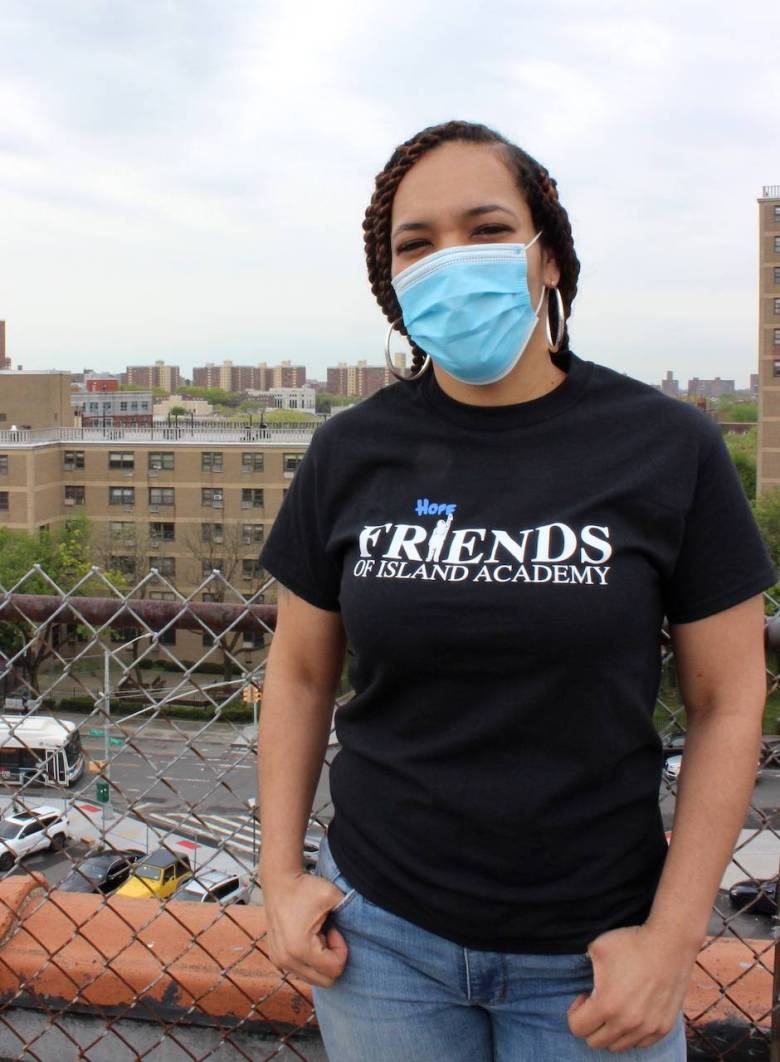 Venus Core stands in front of the Brownsville skyline. Photo: Anna Bradley-Smith for BK Reader.