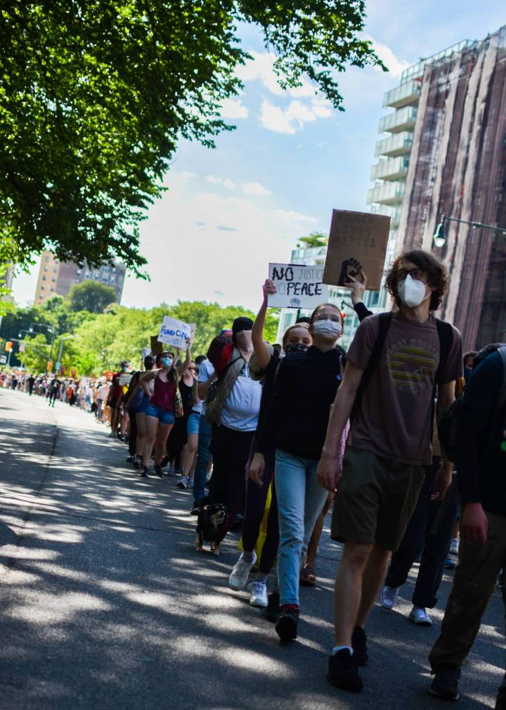 Protesters march through Crown Heights toward Medgar Evers College