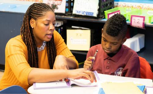 Tiayana Logan working with a student