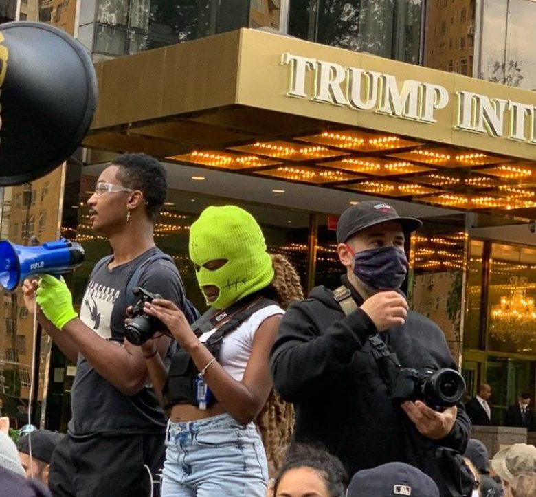 etia Jeune is yellow ski mask at Black Lives Matter protest in front of Trump Tower