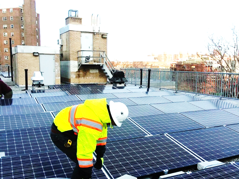 NYCHA resident workers begin installing solar roofs