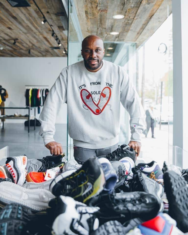 Andre McDonnell with donated shoes.  Photo: Supplied.