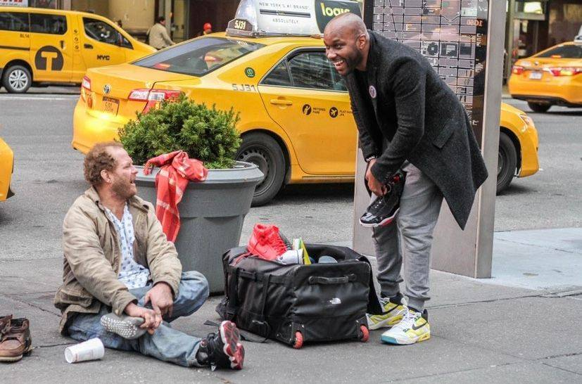 Andre McDonnell, (right) with a client trying on some fresh kicks. Photo: Provided.