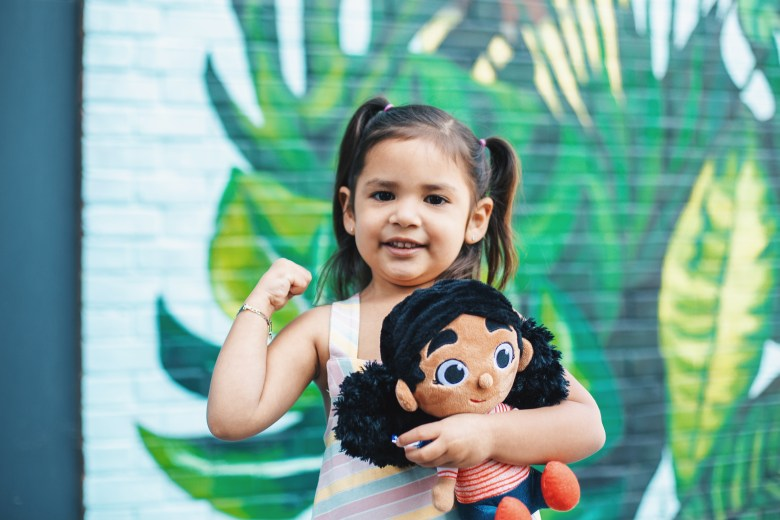 An awesome eater with her Kalamata Doll. Photo: provided.