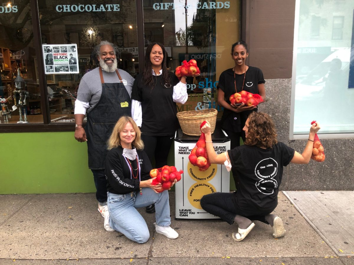 The City Harvest and One Love team filling up the free, community fridge at 432 Myrtle Avenue in Clinton Hill. Photo: Miranda Levingston for the BK Reader.