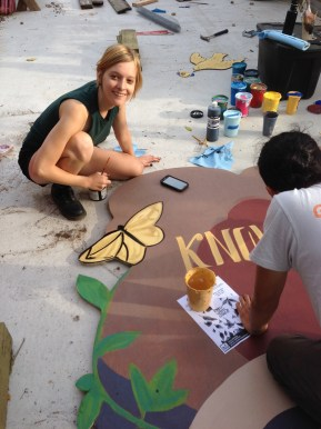 Hilary and Raul work on the sign