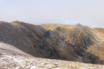 The snow-dusted ridge leading to Stob a' Choire Dhomhain.