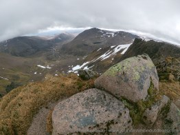 Cairn Toul (centre, distance) and the Lairig Ghur from Braeriach summit.