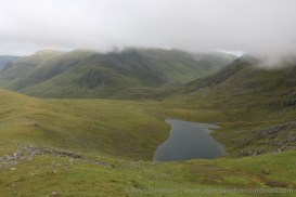 Lochan Gaineanhach in a hidden valley looking over to a cloud-shrouded Maoile Lunndaidh.