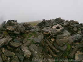 Sgurr a Chaorachain summit - home to a ruined shelter cairn and the remains of a trig point.