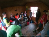 The group takes shelter in the Teahouse bothy.