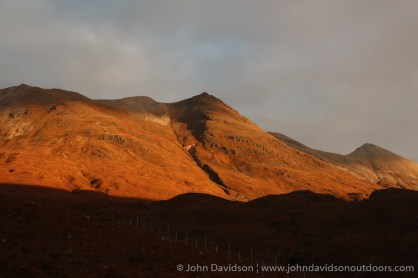 Looking up to Spidean Coire nan Clach on the Beinn Eighe ridge in the early morning sunlight.