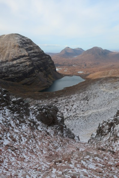 Looking down the stone chute to Loch Coire Mhic Fhearchair and Sail Mhor (left) with Baosbheinn and Beinn an Eoin in the distance.