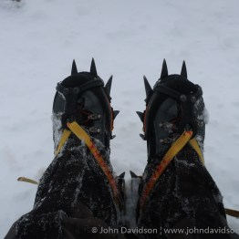 Crampons give extra bite when walking in snow and ice in the mountains.