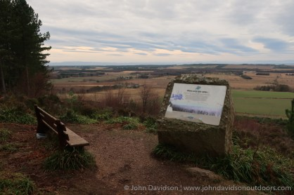 A bench and information panel at the viewpoint.