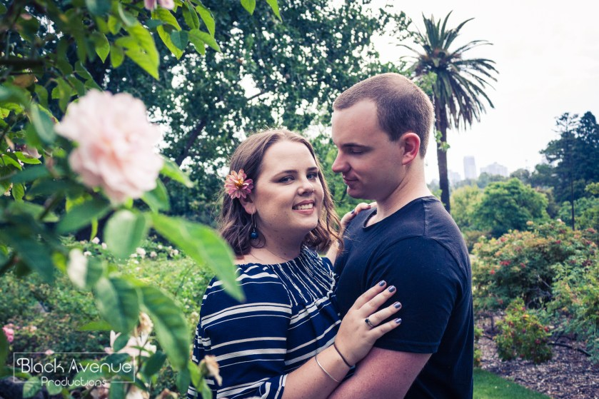 engaged couple taking their pre wedding photo in Royal Botanical garden Melbourne candid style