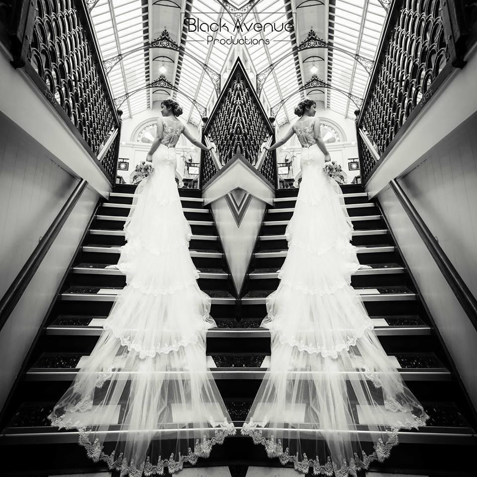 very sexy detailed back on a custom made lace wedding gown by Royal Arcade stairs case in Melbourne