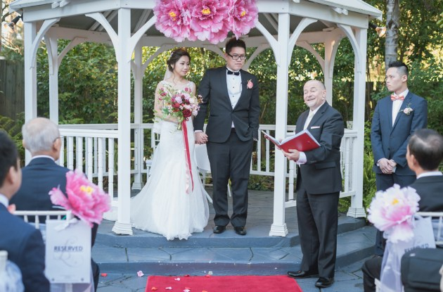 wedding photo of bride groom and marriage celebrant during wedding ceremony at Bram Leigh Receptions Melbourne