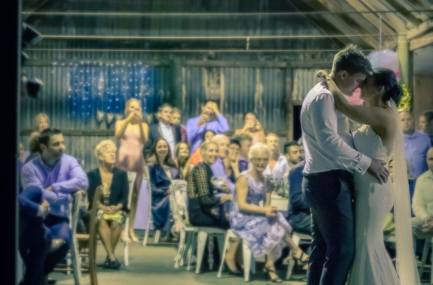 Wedding reception first dance romantic moment in rustic barn in the briars barn warehouse