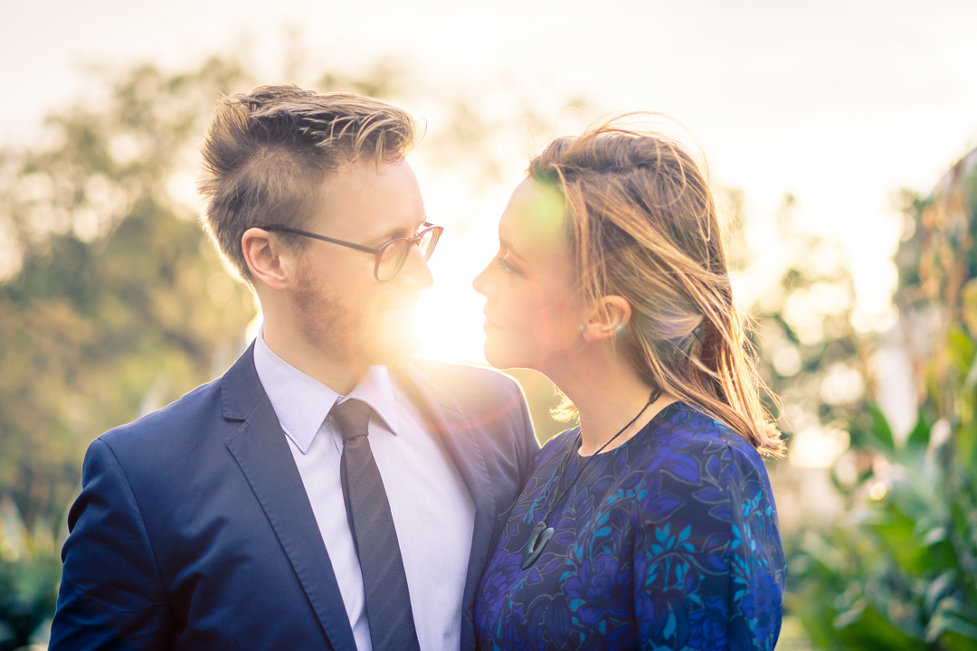 Melbourne wedding photographers capture in love couple looking at each other with sunset background at Fitzroy garden Melbourne 2017
