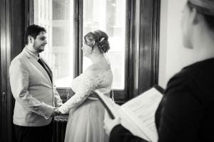 wedding ceremony at Victorian Marriage Registry on Spring Street couple vow to each other in black and white image