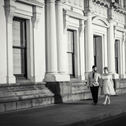 married couple walking down the road at Victorian Marriage Registry capture by Melbourne wedding photographers in Black and White