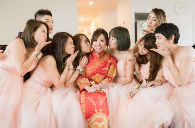 sweet artistic bridal party photo showing bridesmaids kissing bride in Australia