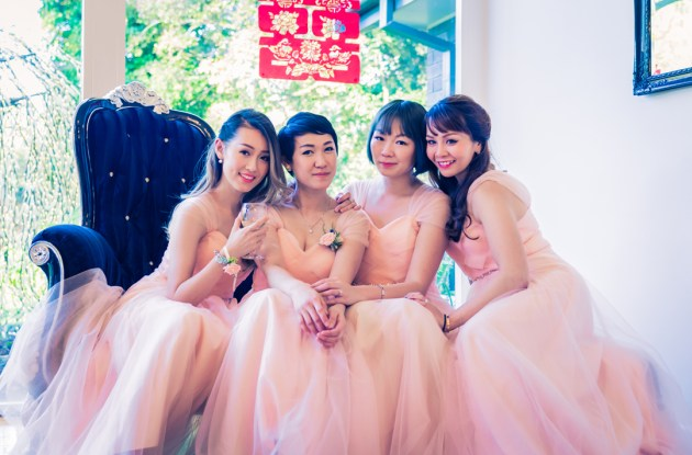 Melbourne wedding venue Bram Leigh Reception photo showing pink dress bridesmaid sitting by piano