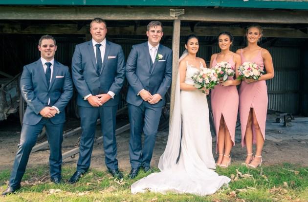 trendy rustic barn wedding bridal party photo