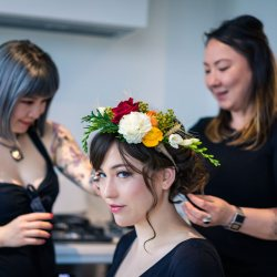makeup artist Eileen Yan Z and destination wedding photographer Lowina Blackman behind the scene applying makeup to Melbourne bride for wedding shoot by Black Avenue Productions