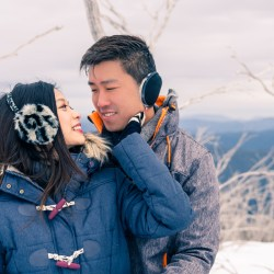 special winter snowy mountain engagement photo showing lover hugging together in skiwear