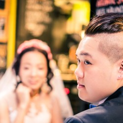 newly wedded couple taking a break to have a coffee on Flinders Lane Melbourne captured by wedding photographer Derek Chan