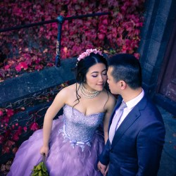 Hong Kong couple taking their pre-wedding photo at St Kilda Melbourne with red leave autumn fall background
