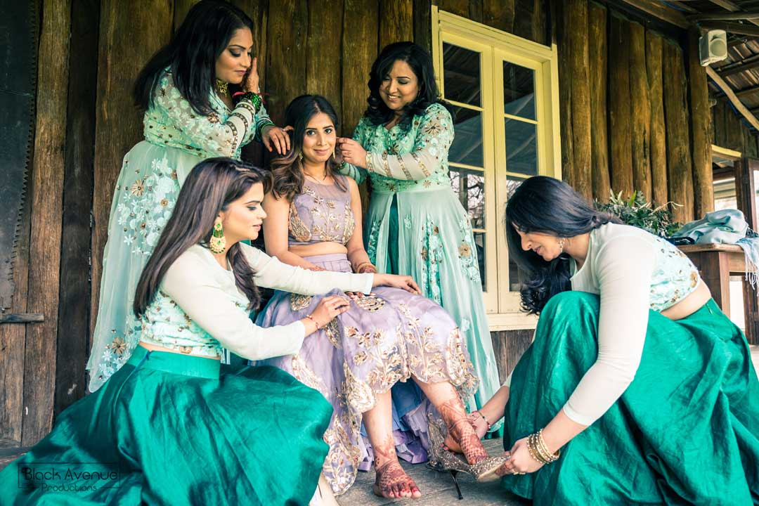 Indian bridesmaids helping bride to get ready for her rustic farmhouse wedding in Baxter Barn Melbourne