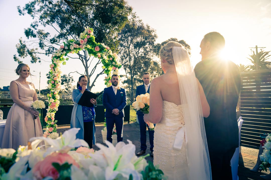 father and bride walking down the aisle under sunset candid photo by Melbourne wedding photographers Derek