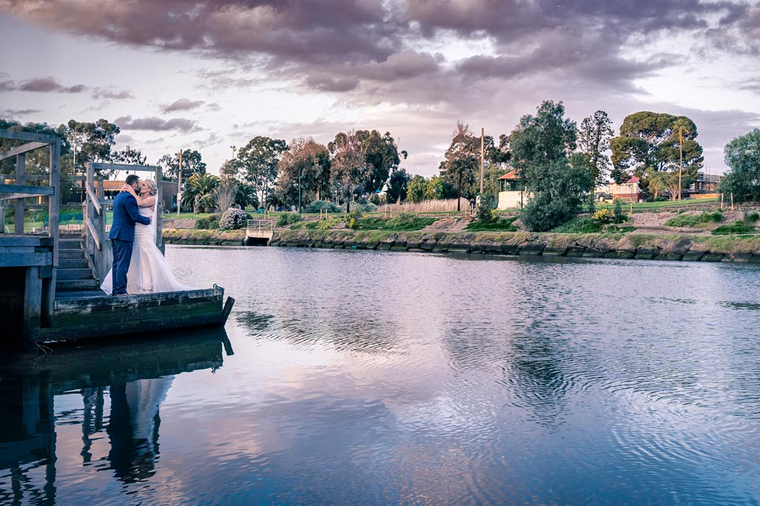romantic wedding photo by the yarra river in Melbourne during sunset magic hour