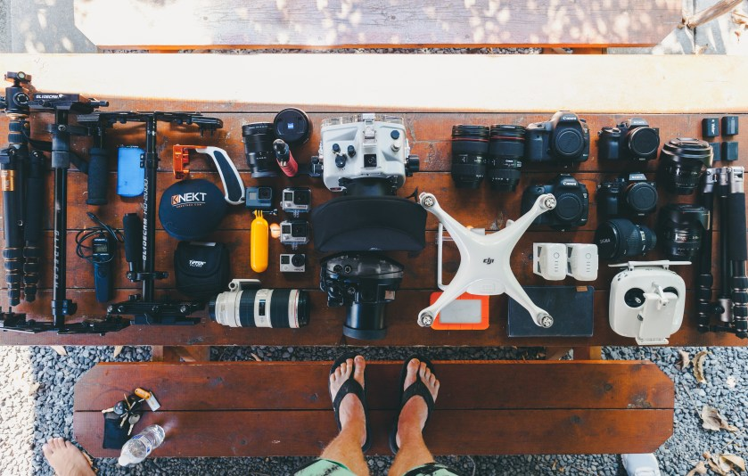 professional wedding videographer cameras and lenses and drones layout